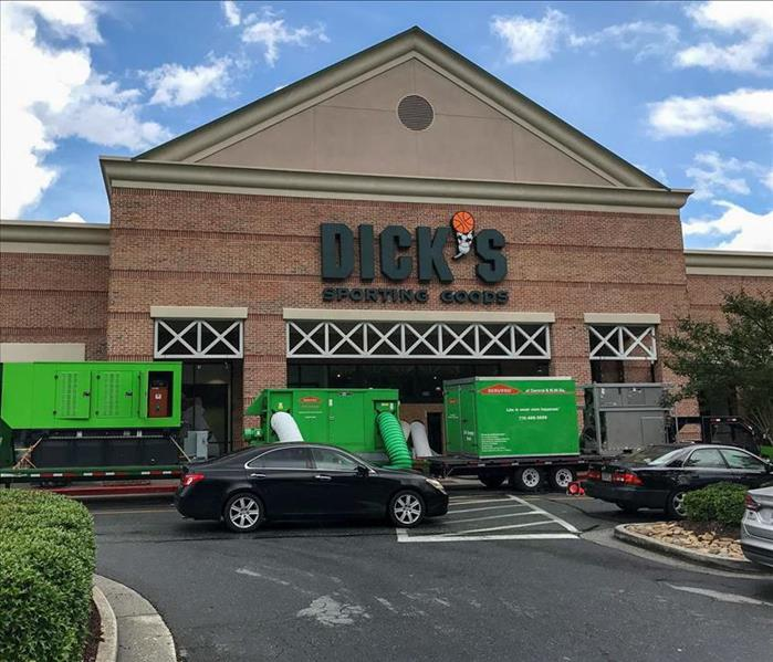 Trucks and commercial dryers in front of a Dick's Sporting Goods in Nashville
