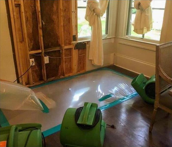 Drywall removal, drying equipment and plastic barrier used to contain damaged area in Nashville, TN