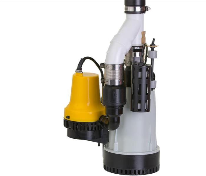 New sump pump with an attached yellow emergency backup pump