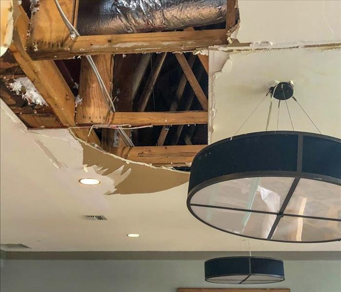 Water damage in the ceiling of a Nashville business due to a storm